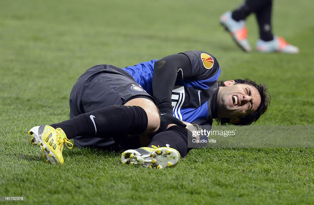 Diego Alberto Milito of FC Inter Milan grimaces as he lies injured on the turf during the UEFA Europa League round of 32 first leg match between FC Internazionale Milano and CFR 1907 Cluj at San Siro Stadium on February 14, 2013 in Milan, Italy.