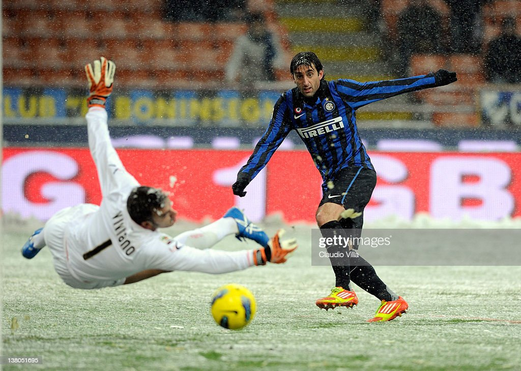 Diego Alberto Milito of FC Inter Milan scores the first goal during the Serie A match between FC Internazionale Milano and US Citta di Palermo at Stadio Giuseppe Meazza on February 1, 2012 in Milan, Italy.
