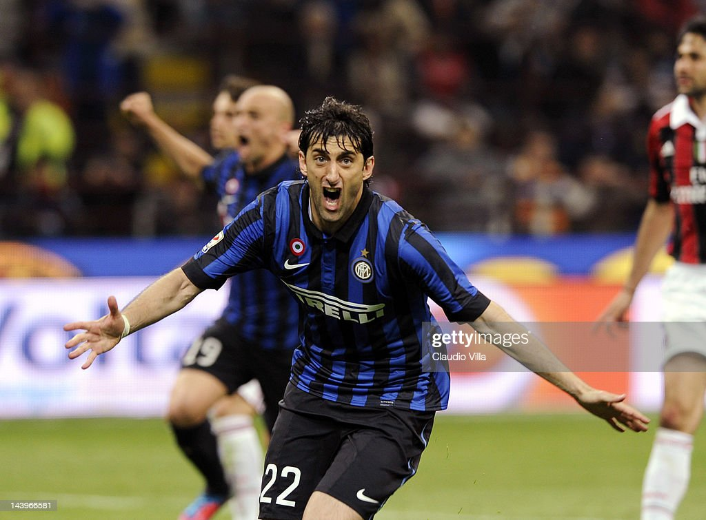 Diego Alberto Milito #22 of Inter Milan celebrates getting a hat trick during the Serie A match between FC Internazionale Milano and AC Milan at Stadio Giuseppe Meazza on May 6, 2012 in Milan, Italy.