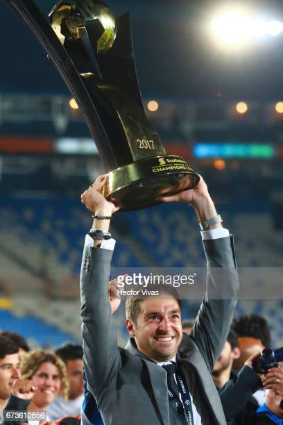 Diego Alonso head coach of Pachuca lifts the trophy to celebrate after his team winning the Final second leg match between Pachuca and Tigres UANL as...