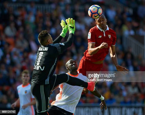 Diego Alves and Eliaquim Mangala of Valencia competes for the ball with Steven N'Zonzi of Sevilla during the La Liga match between Valencia CF and...