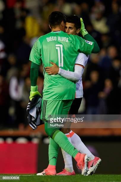 Diego Alves goalkeeper of Valencia CF embraces teammate Joao Cancelo during the La Liga match between Valencia CF and Real Club Celta de Vigo at...