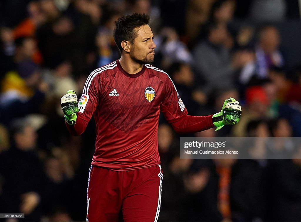 Diego Alves of Valencia celebrates after stopping a penalty during the La Liga match between Valencia CF and Sevilla FC at Estadi de Mestalla on January 25, 2015 in Valencia, Spain.