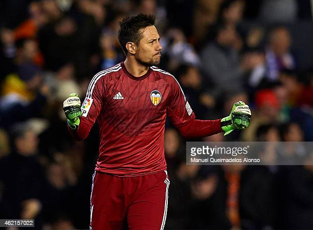 Diego Alves of Valencia celebrates after stopping a penalty during the La Liga match between Valencia CF and Sevilla FC at Estadi de Mestalla on...
