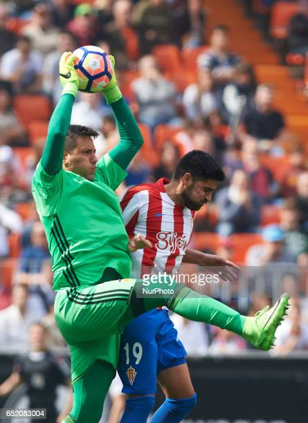 Diego Alves of Valencia CF and Carlos Carmona of Real Sporting de Gijon during their La Liga match between Valencia CF and Real Sporting de Gijon at...