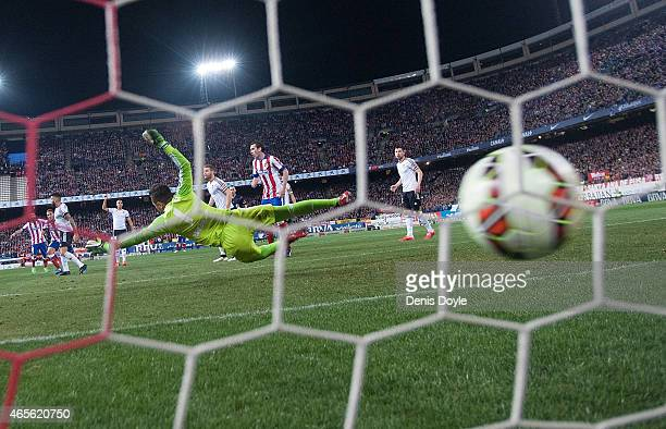 Diego Alves of Valencia CF fails to stop Koke of Club Atletico de Madrid from scoring Atletico's opening goal during the Lia Liga match between Club...