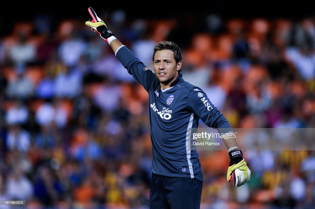 <a gi-track='captionPersonalityLinkClicked' href=/galleries/search?phrase=Diego+Alves&family=editorial&specificpeople=4817250 ng-click='$event.stopPropagation()'>Diego Alves</a> of Valencia CF reacts during the La Liga match between Valencia CF and Sevilla FC at Estadio Mestalla on September 22, 2013 in Valencia, Spain.