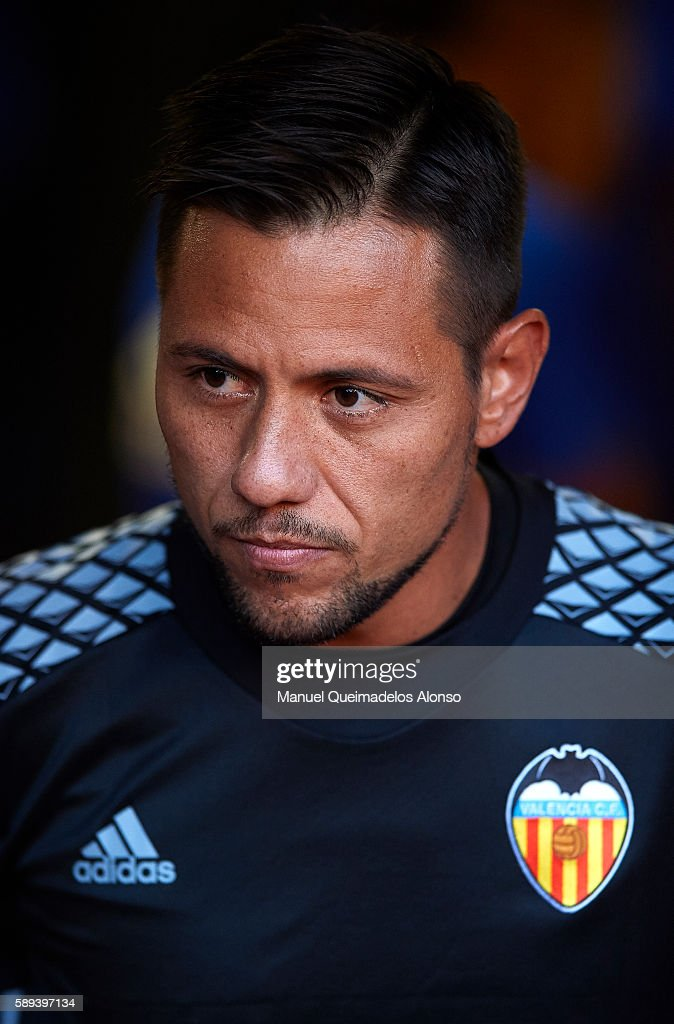 Diego Alves of Valencia looks on during the team official presentation ahead of the pre-season friendly match between Valencia CF and AC Fiorentina at Estadio Mestalla on August 13, 2016 in Valencia, Spain.