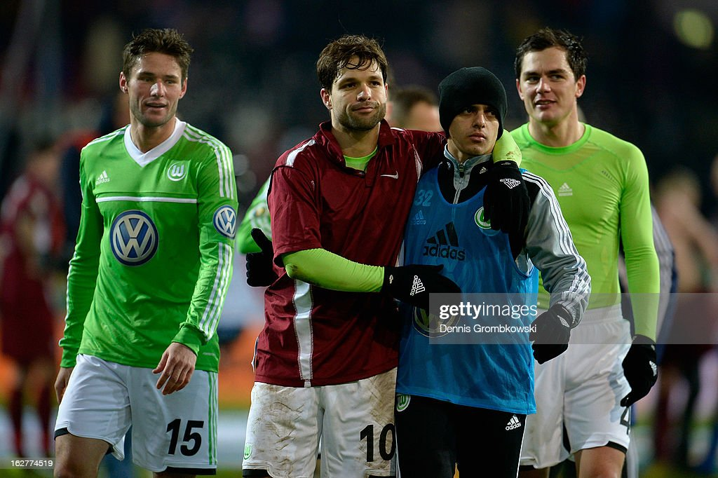Diego and <a gi-track='captionPersonalityLinkClicked' href=/galleries/search?phrase=Fagner&family=editorial&specificpeople=6872878 ng-click='$event.stopPropagation()'>Fagner</a> of Wolfsburg celebrate after the DFB Cup match between Kickers Offenbach and VfL Wolfsburg on February 26, 2013 in Offenbach, Germany.