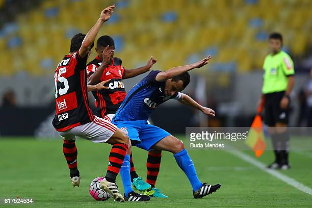 Diego and Marcio Araujo of Flamengo struggle for the ball with Rodriguinho of Corinthians during a match between Flamengo and Corinthians as part of...