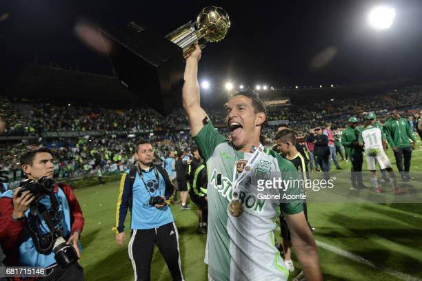 Diego Arias of Nacional lifts the trophy to celebrate after winning a match between Atletico Nacional and Chapecoense as part of CONMEBOL Recopa...