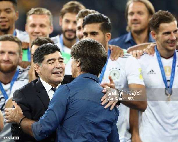Diego Armando Maradona congratulates head coach Joachim Loew of Germany after the FIFA Confederations Cup Russia 2017 final between Chile and Germany...