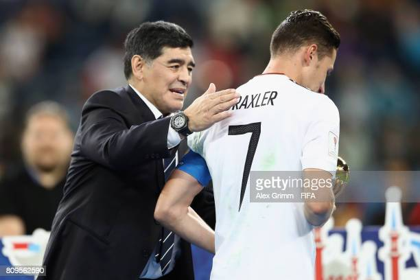 Diego Armando Maradona congratulates Julian Draxler of Germany after the FIFA Confederations Cup Russia 2017 final between Chile and Germany at Saint...