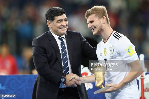 Diego Armando Maradona congratulates Timo Werner of Germany for winning the adidas Golden Boot after the FIFA Confederations Cup Russia 2017 final...