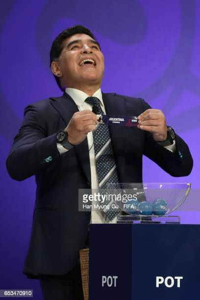 Diego Armando Maradona holds up the name of Argentina during the draw for the FIFA U20 World Cup Korea Republic 2017 at Suwon SK Artrium on March 15...