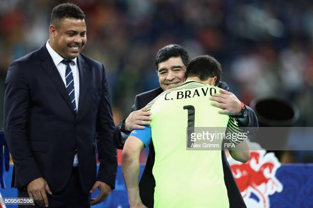 Diego Armando Maradona hugs goalkeeper Claudio Bravo of Chile after the FIFA Confederations Cup Russia 2017 final between Chile and Germany at Saint...