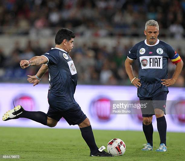 Diego Armando Maradona with his teammate Roberto Baggio in action during the Interreligious match for Peace at Olimpico Stadium on September 1 2014...
