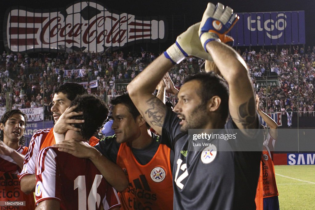 Diego Barreta from Paraguay and his team-mates celebrate a goal during a match between Perú and Paraguay as part of of the South American Qualifiers for FIFA World Cup Brazil 2014 at Defensores del Chaco Stadium on Octuber 16, 2012 in Asuncion, Paraguay.