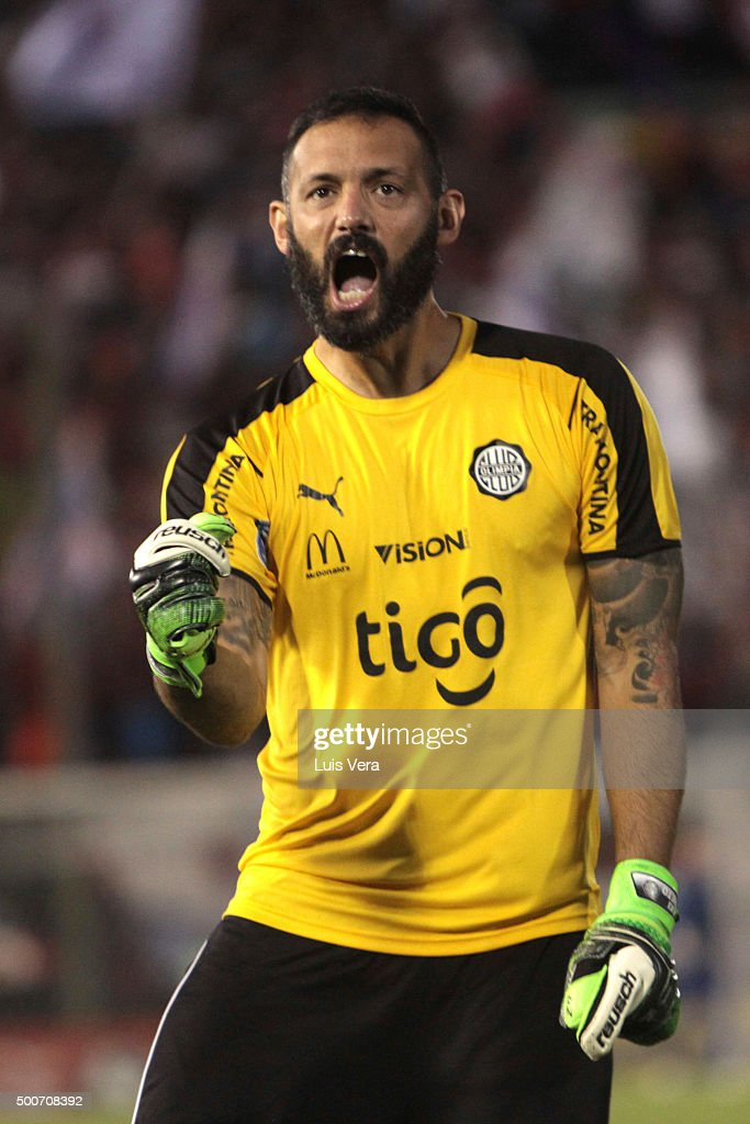 <a gi-track='captionPersonalityLinkClicked' href=/galleries/search?phrase=Diego+Barreto&family=editorial&specificpeople=2939685 ng-click='$event.stopPropagation()'>Diego Barreto</a> of Olimpia celebrates the first goal of his team scored by Freddy Barreiro (Not in Frame) during a playoff final match between Cerro Porteño and Olimpia as part of Torneo Apertura 2015 at Defensores del Chaco Stadium on December 09, 2015 in Asuncion, Paraguay.