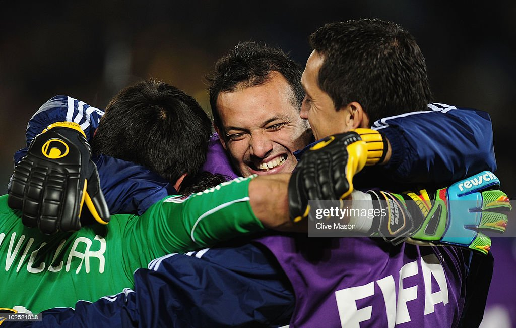 <a gi-track='captionPersonalityLinkClicked' href=/galleries/search?phrase=Diego+Barreto&family=editorial&specificpeople=2939685 ng-click='$event.stopPropagation()'>Diego Barreto</a> of Paraguay hugs fellow goalkeepers <a gi-track='captionPersonalityLinkClicked' href=/galleries/search?phrase=Justo+Villar&family=editorial&specificpeople=564566 ng-click='$event.stopPropagation()'>Justo Villar</a> (L) and <a gi-track='captionPersonalityLinkClicked' href=/galleries/search?phrase=Aldo+Bobadilla&family=editorial&specificpeople=553920 ng-click='$event.stopPropagation()'>Aldo Bobadilla</a> as they celebrate winning the penalty shootout that sends Paraguay through to the quarter finals during the 2010 FIFA World Cup South Africa Round of Sixteen match between Paraguay and Japan at Loftus Versfeld Stadium on June 29, 2010 in Pretoria, South Africa.