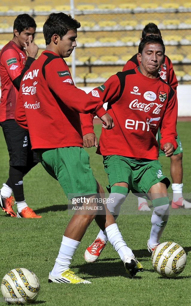 Diego Bejarano (L) and Jair Torrico, take part in a training session of the Bolivian national football team in La Paz on March 19, 2013. Bolivia will face Colombia on march 22 and Argentina on march 26 in matches of the Brazil 2014 FIFA World Cup South American qualifier.