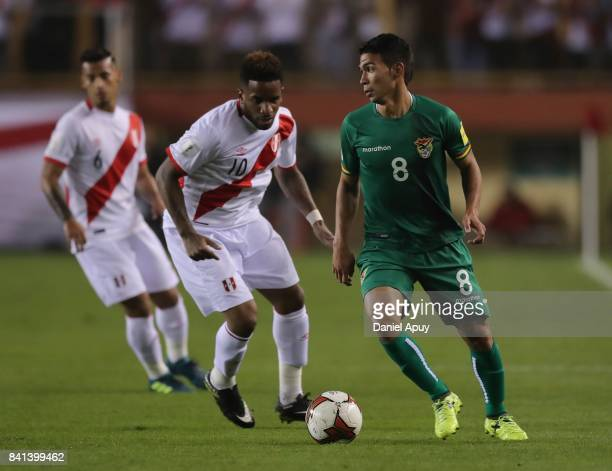 Diego Bejarano of Bolivia fights for the ball with Jefferson Farfan of Peru during a match between Peru and Bolivia as part of FIFA 2018 World Cup...
