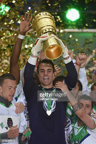 Diego Benaglio of VfL Wolfsburg lifts the trophy after his teams victory in the DFB Cup Final match between Borussia Dortmund and VfL Wolfsburg at...