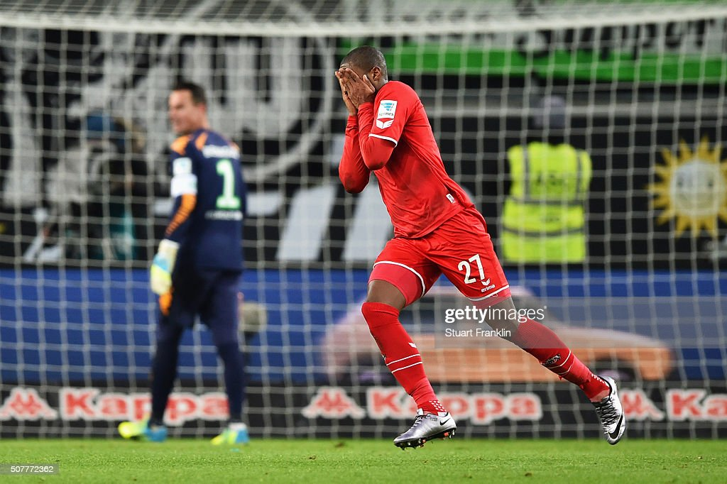 <a gi-track='captionPersonalityLinkClicked' href=/galleries/search?phrase=Diego+Benaglio&family=editorial&specificpeople=543817 ng-click='$event.stopPropagation()'>Diego Benaglio</a> of VfL Wolfsburg (1) looks dejected as Anthony Modeste of Cologne celebrates as he scores their first and equalising goal during the Bundesliga match between VfL Wolfsburg and 1. FC Koeln at Volkswagen Arena on January 31, 2016 in Wolfsburg, Germany.