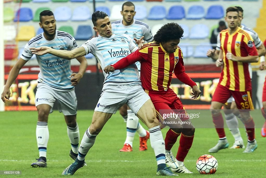 Diego Biseswar of Kayserispor in action against Mehmet Topal of Fenerbahce during the Turkish Spor Toto Super League football match between...