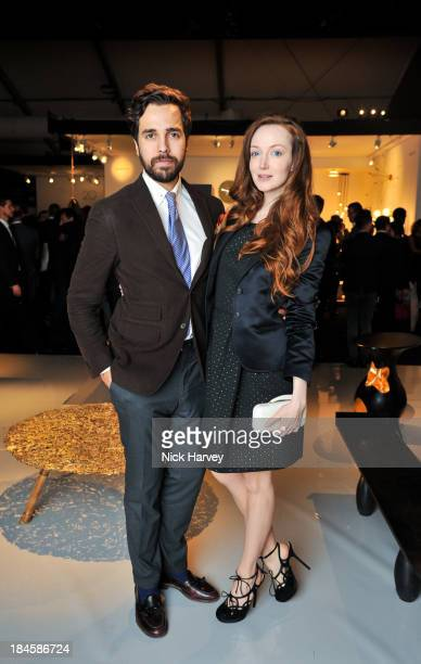 Diego BiveroVolpe and Olivia Grant attend the collectors preview for PAD London at Berkeley Square Gardens on October 14 2013 in London England
