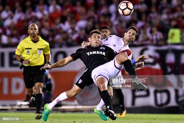 Diego Braghieri of Lanus and Ignacio Fernandez of River Plate fight for the ball during a first leg match between River Plate and Lanus as part of...