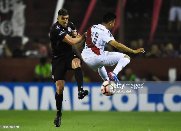 Diego Braghieri of Lanus fights for the ball with Gonzalo Martinez of River Plate during a second leg match between Lanus and River Plate as part of...