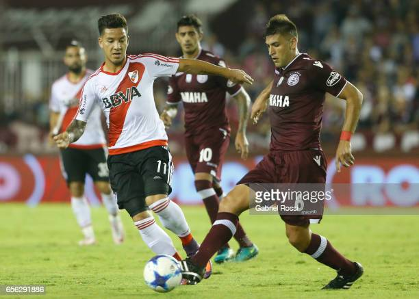 Diego Braghieri of Lanus fights for the ball with Sebastian Driussi of River Plate during a match between Lanus and River Plate as part of Torneo...