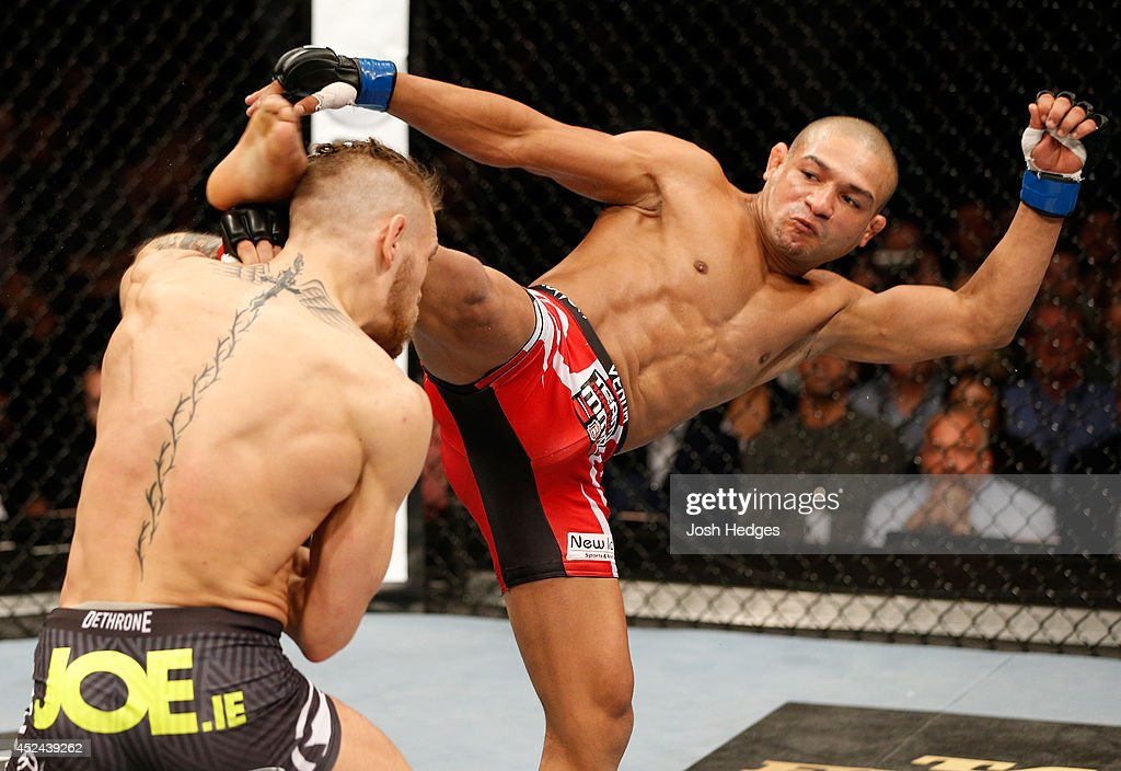 http://media.gettyimages.com/photos/diego-brandao-kicks-conor-mcgregor-in-their-featherweight-bout-during-picture-id452439262