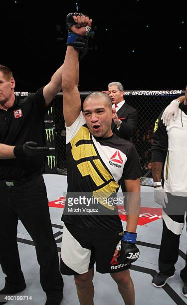 Diego Brandao of Brazil celebrates after his first round win over Katsunori Kikuno of Japan in their featherweight bout during the UFC event at the...