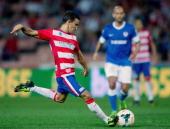 Diego Buonanotte of Granada CF strikes the ball during the La Liga match between Granada CF and Athletic Club at Estadio Nuevo Los Carmenes on...