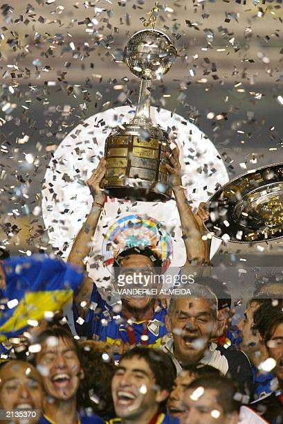 Diego Cagna captain of Boca Juniors of Argentina holds the trophy after winning the Libertadores Cup 02 July 2003 at the Morumbi Stadium in Sao Paulo...