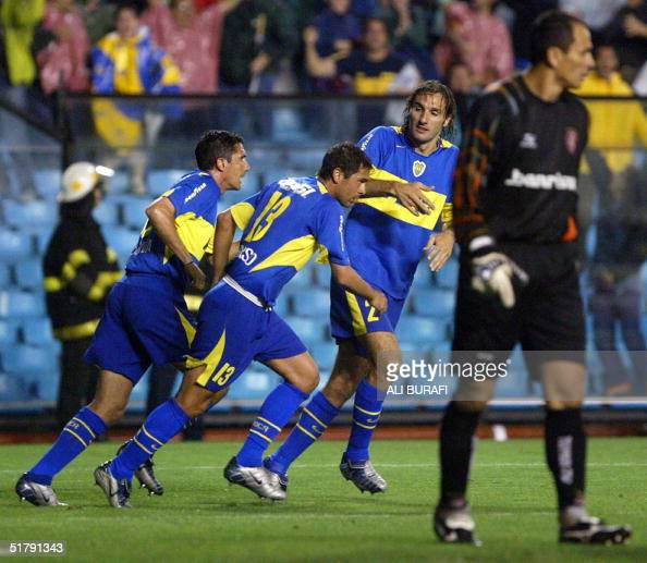 Diego Cagna Cristian Traverso and Rolando Schiavi of Boca Juniors of Argentina celebrate passing goalkeeper Clemer after scoring the first goal...
