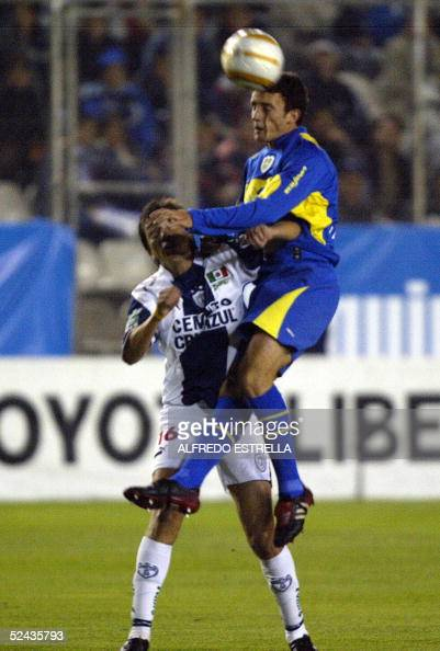 Diego Cagna of Boca Juniors of Argentina fights with Cesareo Victorino of Pachuca of Mexico during their Copa Sudamericana football match at Pachuca...