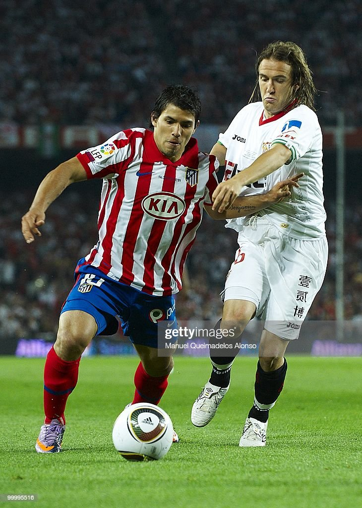 Diego Capel (R) of Sevilla and Kun Aguero of Atletico de Madrid compete for the ball during the Copa del Rey final between Atletico de Madrid and Sevilla at Camp Nou stadium on May 19, 2010 in Barcelona, Spain.