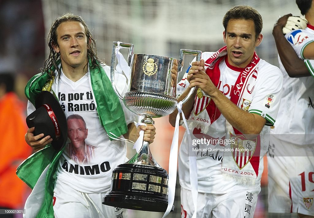 Diego Capel (L) of Sevilla celebrates with his teammate Lolo after winning the Copa del Rey final between Atletico de Madrid and Sevilla at Camp Nou stadium on May 19, 2010 in Barcelona, Spain. Sevilla won 2-0.