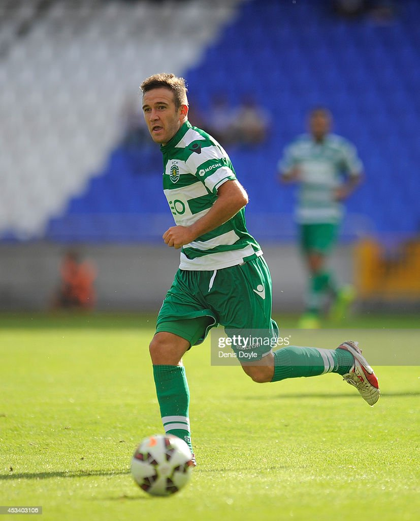 <a gi-track='captionPersonalityLinkClicked' href=/galleries/search?phrase=Diego+Capel&family=editorial&specificpeople=4164836 ng-click='$event.stopPropagation()'>Diego Capel</a> of Sporting Clube de Portugal in action during the Teresa Herrera Trophy match between Real Sporting and Sporting Clube de Portugal at Estadio Municipal de Rizor on August 9, 2014 in A Coruna, Spain.