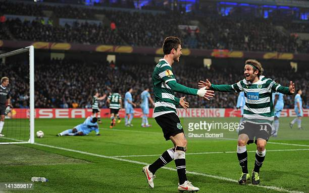 Diego Capel of Sporting Lisbon celebrates with goal scorer Ricky van Wolfswinkel of Sporting Lisbon after he scored their second goal during the UEFA...