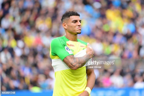 Diego Carlos of Nantes injures his shoulder during the Ligue 1 match between FC Nantes and Olympique Marseille at Stade de la Beaujoire on August 12...