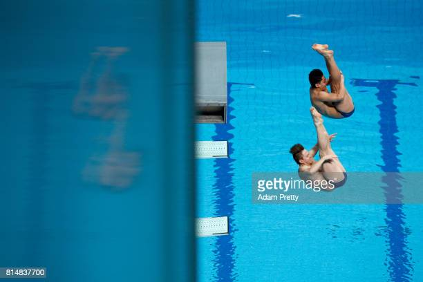 Diego Carquin of Chile and Donato Neglia of Chile competes during the Men's Diving 3m Sychro Springboard Preliminary Round on day two of the Budapest...