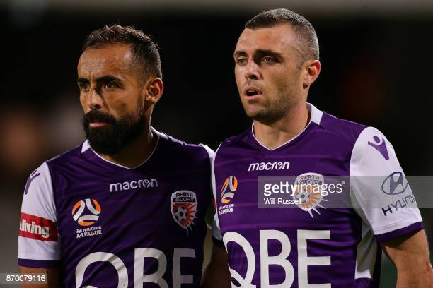 Diego Castro and Mitchell Mallia of the Glory line up against a penalty kick during the round five ALeague match between the Perth Glory and Adelaide...