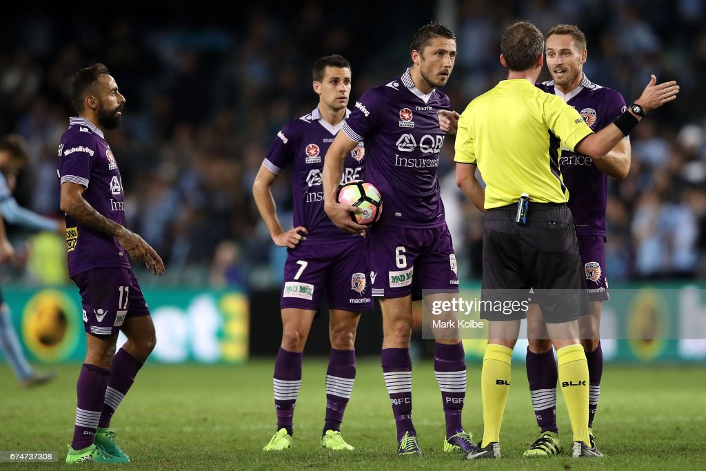 Diego Castro, Joel Chianese, Dino Djulbic and Rostyn Griffiths of the Glory argue with the referee Pweter Green after a Sydney FC goal during the A-League Semi Final match between Sydney FC and the Perth Glory at Allianz Stadium on April 29, 2017 in Sydney, Australia.