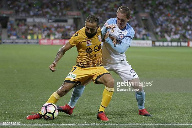 Diego Castro of Perth Glory and Neil Kilkenny of Melbourne City compete for the ball during the round 12 ALeague match between Melbourne City and...