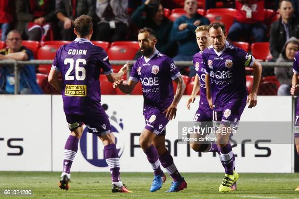 Diego Castro of Perth Glory celebrates with teammates after he scored from a penalty during the round 25 ALeague match between Adelaide United and...