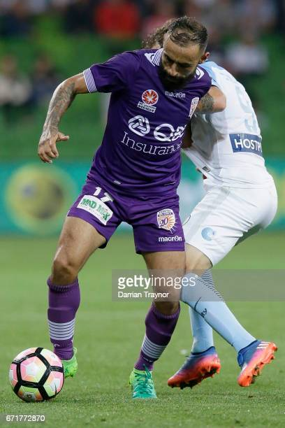 Diego Castro of Perth Glory controls the ball as Nicolas Colazo of Melbourne City applies pressure during the ALeague Elimination Final match between...